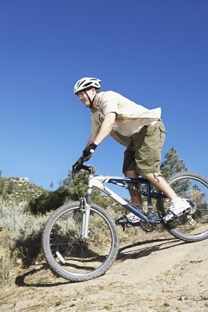 Young Man Mountain Biking on Rugged Trail Stock Photo - 5313048