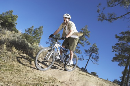 mountainbike: Young Man Going Off Road on Mountain Bike