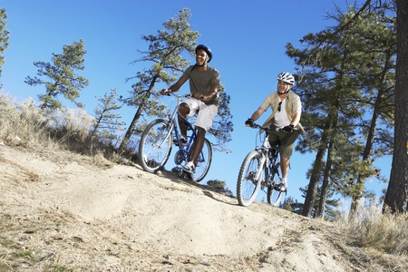 Two Young Men on Mountain Bike Trail