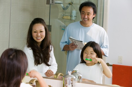 Family in Bathroom Getting Ready for Day Stock Photo - 5404637