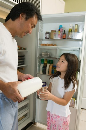 Father Pouring Milk For Daughter Stock Photo - 5404640