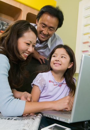 Family Using Laptop Together Stock Photo - 5404642