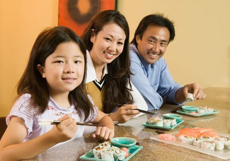 Family Eating Sushi Together Stock Photo - 5404643