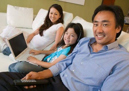 Family Relaxing in Living Room with Laptop Stock Photo - 5404648