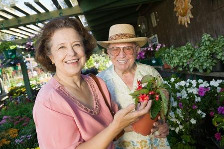 opting: Senior Couple Shopping for Plants