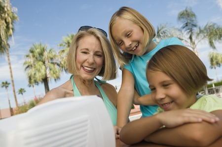Girls and Grandmother Watching TV at Pool Stock Photo - 5404674