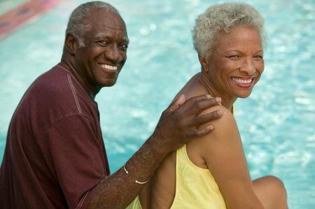 only senior women: Senior Couple Relaxing Poolside