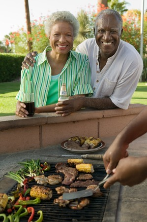 Senior Couple Together at Outdoor Barbecue Stock Photo - 5404705