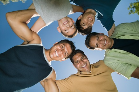 Men in a Huddle Stock Photo - 5404721