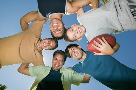 Men in a Football Huddle Stock Photo - 5404723