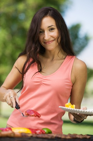 Woman Grilling Food at Park Stock Photo - 5412274