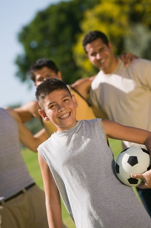 Teenager and Men at the Park Stock Photo - 5412284