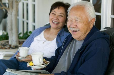 60s adult: Older Couple Drinking Tea