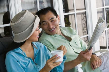 Couple Drinking Coffee and Reading Newspaper Together Stock Photo - 5412294