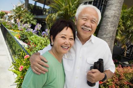 Smiling Couple with Binoculars Stock Photo - 5412307