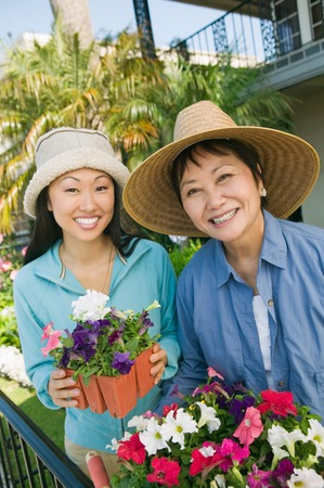 early 30s: Mother and Daughter Gardening Together
