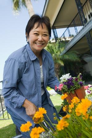 late fifties: Woman Enjoying Gardening