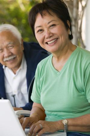 older men: Woman Using Laptop