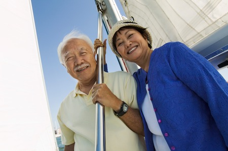 early fifties: Smiling Couple on Sailboat LANG_EVOIMAGES