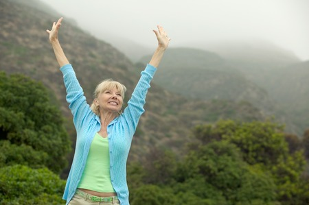 Excited Woman Raising Arms Stock Photo - 5412331