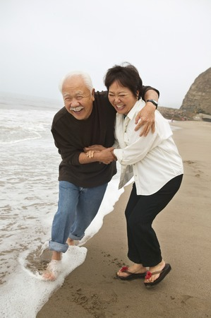 Mature Couple Playing in Water Stock Photo - 5404467