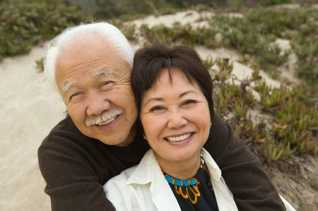 Mature Couple Sitting at Beach Stock Photo - 5412337