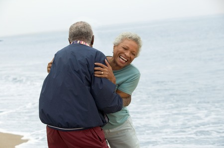 Frisky Mature Couple at Beach Stock Photo - 5412341