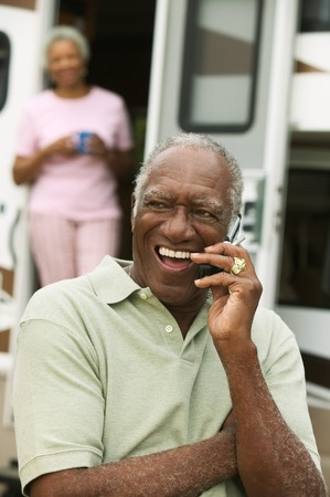 early 60s: Middle-Aged Man Keeping in Touch During RV Trip