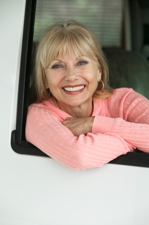 late forties: Smiling Woman in RV LANG_EVOIMAGES