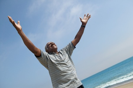 late fifties: Very Happy Middle-Aged Man at Beach LANG_EVOIMAGES