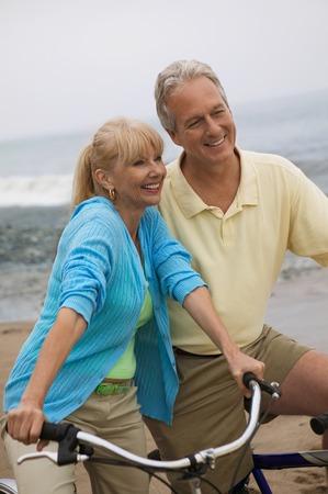 Couple on Bike Ride at Beach Stock Photo - 5412361