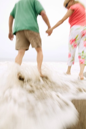 Couple Getting Feet Wet at Beach Stock Photo - 5412366