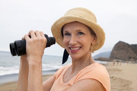 Woman at Beach Using Binoculars Stock Photo - 5412371
