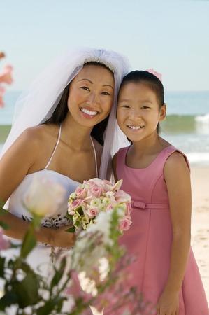 twentysomething: Bride and Sister on Beach