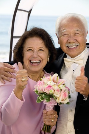 Happy Parents at Wedding Giving Thumbs-Up Stock Photo - 5412417
