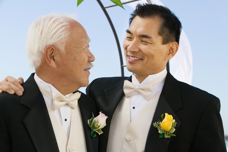 wedding customs: Groom With Arm Around Father LANG_EVOIMAGES