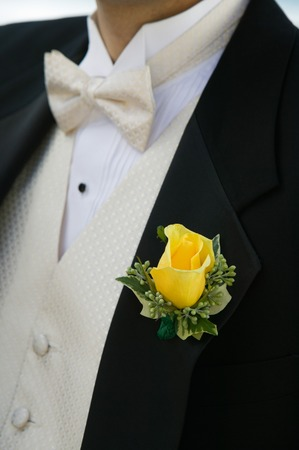 wedding customs: Close-up of Yellow Rose on Grooms Tuxedo