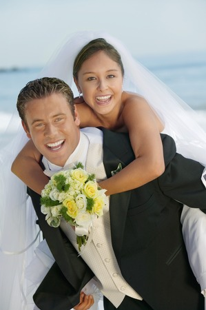 wedding customs: Groom Giving Bride a Piggyback Ride