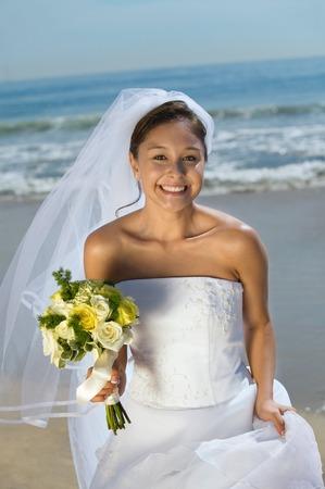 wedding customs: Happy Bride on Beach With Bouquet