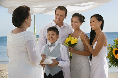 preteens beach: Bride and Groom on Beach With Family LANG_EVOIMAGES