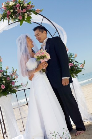 beach wear: Bride and Groom Under Archway