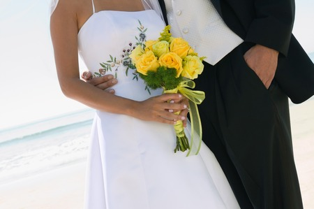 beach wear: Bride and Groom With Bouquet on Beach