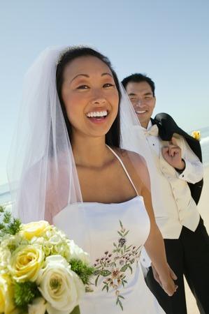 bridegrooms: Bride and Groom on Beach