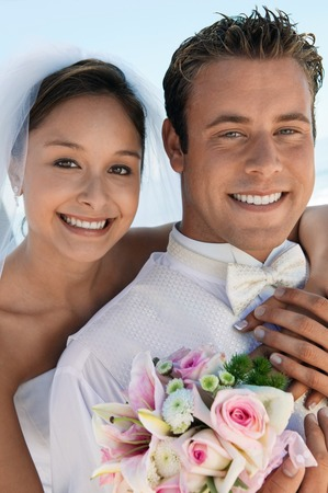 arm bouquet: Bride and Groom With Bouquet on Beach