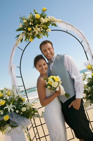 Bride and Groom Under Archway on Beach Stock Photo - 5412454