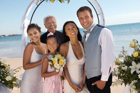 Bride and Groom With Family on Beach Stock Photo - 5419819