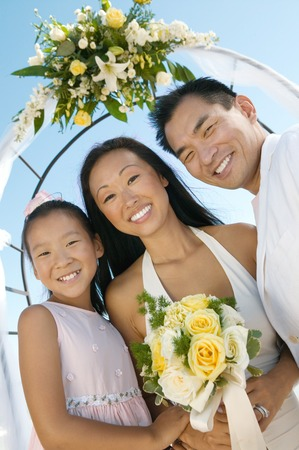 Bride and Groom With Sister Under Archway Stock Photo - 5419820