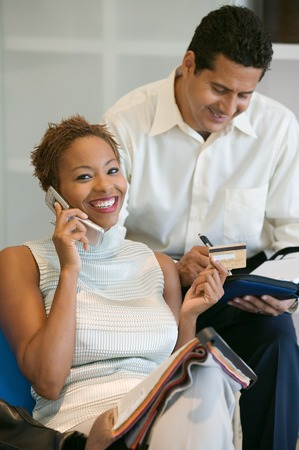 Couple Making a Purchase With Credit Card Stock Photo - 5419830