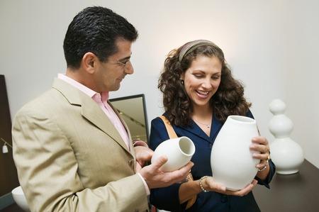 decisionmaking: Couple Examining Vases