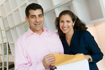 Couple Examining Fabric Swatches Stock Photo - 5419839